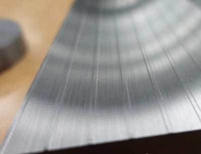 The surface of the workpiece shows ripples caused by vibration